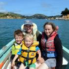 Wayne Johnson, Anna Hughes and their sons, Eli (left) and Niwha, head for home after a day in...