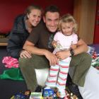 Wayne Oxenham, with the help of wife Lynne and daughter Ashley, packs his bag full of sweets in...