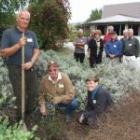Otago Conservation board members Hoani Langsbury (left), Jim Williams and Abby Smith plant a...