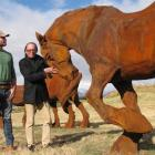 Wellington artist Max Patte (left) and Sir Michael Hill yesterday  inspect elements of Patte's...