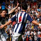 West Bromwich Albion's Zoltan Gera (L) celebrates his goal against Liverpool with Shane Long...
