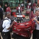 West Indies batsman Xavier Marshall (left) and team physio CJ Clark load gear into the team truck...