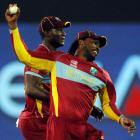 West Indies' captain Darren Sammy and Chris Gayle celebrate the dismissal of Pakistan's Mohammad...