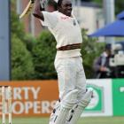 West Indies fast bowler Jerome Taylor shows his delight at scoring his maiden test century...