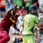 West Indies' Jason Holder celebrates dismissing Pakistan's Ahmed Shahzad (R) during their Cricket...