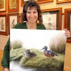 Westwood-based wildlife artist Karen Baddock (44) with her painting of New Zealand shoveller...