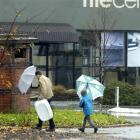 Wet and windy weather did not deter these Dunedin shoppers yesterday. Photo by Gregor Richardson.