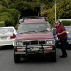 Whai Walker, of Rockside Rd, in Dunedin, talks to neighbour and driver of the 4WD Jeff Huuskes,...