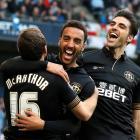 Wigan Athletic's James Perch (C) celebrates with teammates James McArthur (L) and Jordi Gomez...