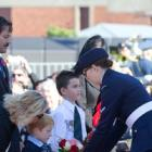 Willy Apiata, VC, escorts the Hopkins and Grant families while they place wreaths during the...