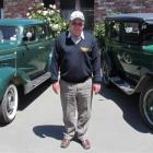 Windsor Rally organiser John Miller, with his 1937 Chevrolet Tour Sedan to his right and his 1928...