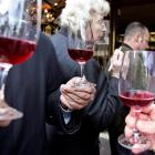 Wine lovers test the Beaujolais Nouveau at a wine dealer in Paris in this 2005 AP file photo.