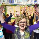 Winner of this year's most inspiring teacher award Jan Stevens celebrates with pupils from the...