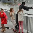 Winter holiday entertainment aplenty for these children during one of July's high tides at the St...