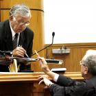 Witness Peter Hentschel (left) and defence counsel Michael Reed QC point to the murder weapon.