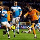 Wolverhampton Wanderers' Steven Fletcher (R) scores his second goal against Sunderland during...