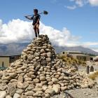 Worker Frank De Lorenzo stands on a stone cairn, reminiscent of Lindis Pass rock piles, at the...