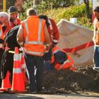 Workers assess the scene were a Chorus contractor received an electric shock after striking an...