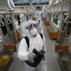 Workers in protective gear disinfect a subway train in Seoul. Photo: Reuters