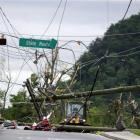 Workers use heavy machinery to clear power lines in after a tornado hit Georgia. (AP Photo/Billy...