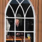 Working in the Naseby Library, Dave Carraher prepares a walking tour of the township. Photo by...