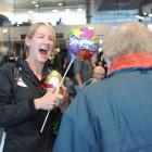 World champion cyclist Alison Shanks is greeted by her grandmother, Madelene Barkman, at Dunedin...