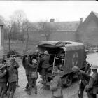 Wounded New Zealand soldiers are placed in a motorised ambulance in France in 1918 in  World War...