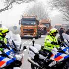 Wreckage from Malaysia Airlines flight MH17 arrives at a Dutch airforce base in the southern town...