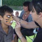 Xavier Sadlier (11) gets the big cat treatment from Sara Clark. Photos by Joe Dodgeshun.