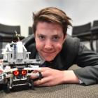 Year 12 Bayfield High School pupil Braden Smitheram on the floor with the competition robot he...