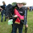 Young cattle handler Thomas Hayward (10) has his sights set on becoming an Angus cattleman. Photo...