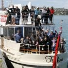Young people and supporters prepare to go cruising on the luxury launch MV Tiakina at the weekend...