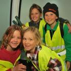 Young volunteers going up in the gondola ready to pull out wilding conifers yesterday are (front,...