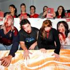 Zombies (from left) Andrew Moar, Corey Haley, Abigail Pigden and Jemima Pigden emerge from a...