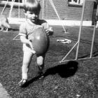 A 3-year-old  Michael ''Woody'' Woodhouse playing in the back yard of his family home in...