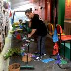 Alley Cantina manager and head chef Lenin Matahaere cleans up a mess left by vandals early...