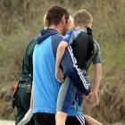 Brighton Surf Club life guard Scott Weatherall carries the boy to an ambulance after the child ...