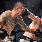 Craig Masina (left) is hit by Mike Pascoe in the 84kg division at the Edgar Centre on Saturday...