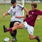 Dunedin Technical defender Ben Allan (right) tackles Roslyn-Wakari midfielder Tennessee Kinghorn...