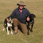 Farmer Boyd Tisdall and two of his dogs. Photo supplied.