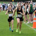 Hill City-University runner Shireen Crumpton (left) tags team-mate Bella Bloomfield during  the...