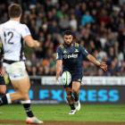 Lima Sopoaga looks to kick during the Highlanders' loss to the Sharks. Photo: Getty Images