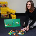 Mosgiel library assistant Lauryn Urquhart-Eaton demonstrates her construction prowess ahead of...