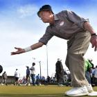 Otago Boys' High School old boy Murray Wyatt (82), of Dunedin delivers a bowl in the fours during...