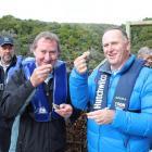 Sanfords southern aquaculture manager Tommy Foggo (left) and Prime Minister John Key sample...