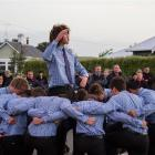 South Otago High School pupil Josh Hill leads his first XV rugby teammates in a haka at the Anzac...