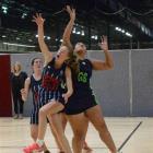 St Hilda's Senior A goal keep Mara McCurdy and College A goal shoot Isabella Masani battle for...