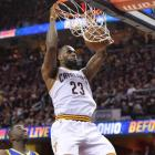 Cleveland's LeBron James dunks the ball in front of Golden State's Draymond Green during the...