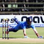 India's Lokesh Rahul dives to avoid being run out. Photo Reuters