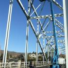 A Fulton Hogan worker cleans pigeon droppings off the Alexandra bridge yesterday  as part of...